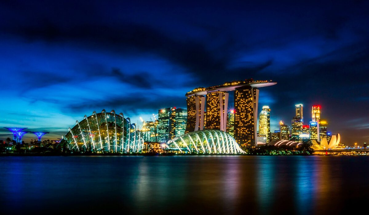 Singapore, Singapore city at night with light reflection in water