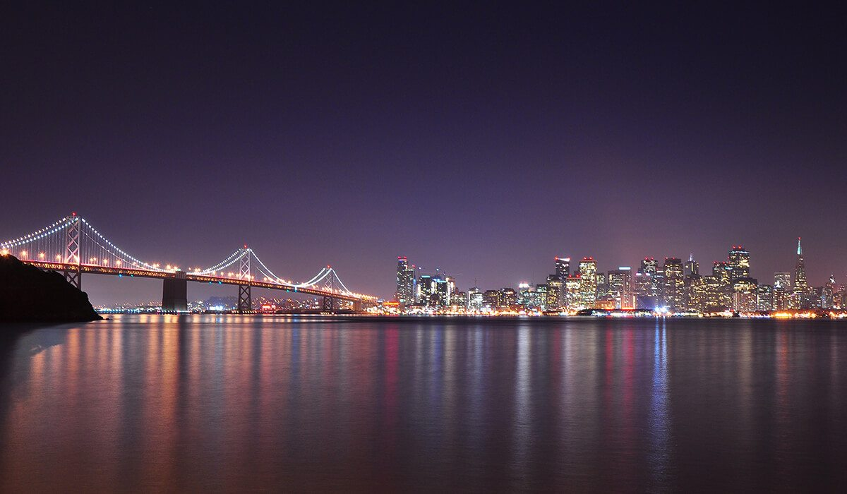 San Francisco, USA city at night with bridge and water