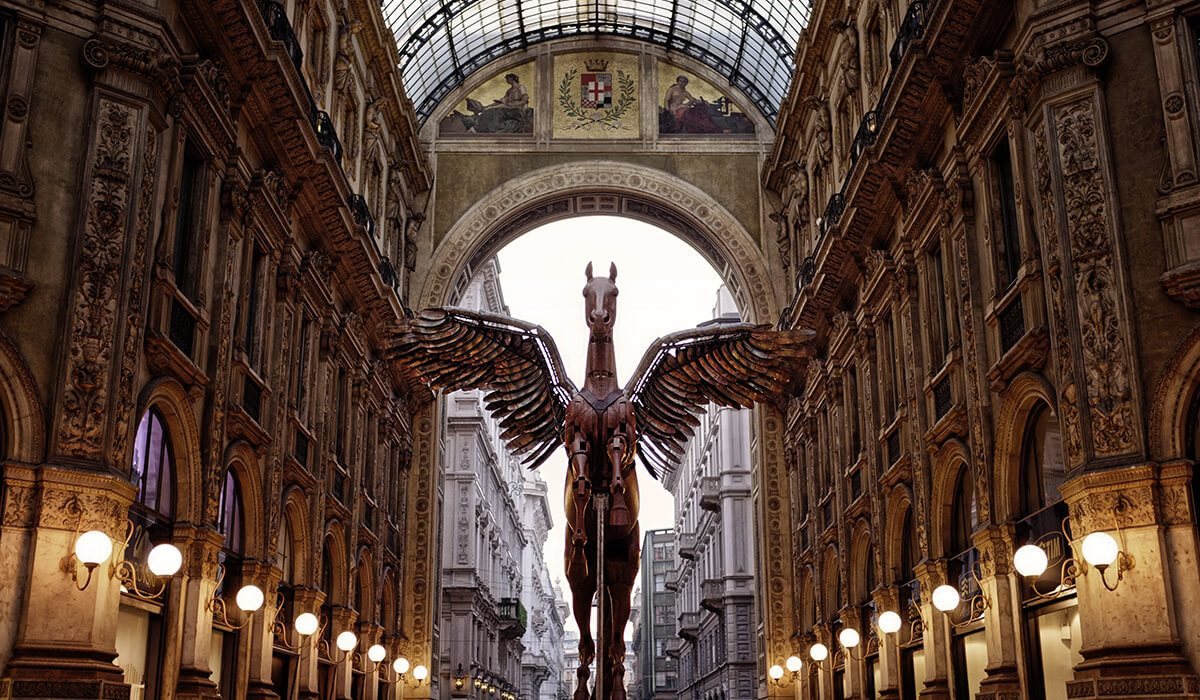 Milan, Italy pegasus statue between buildings