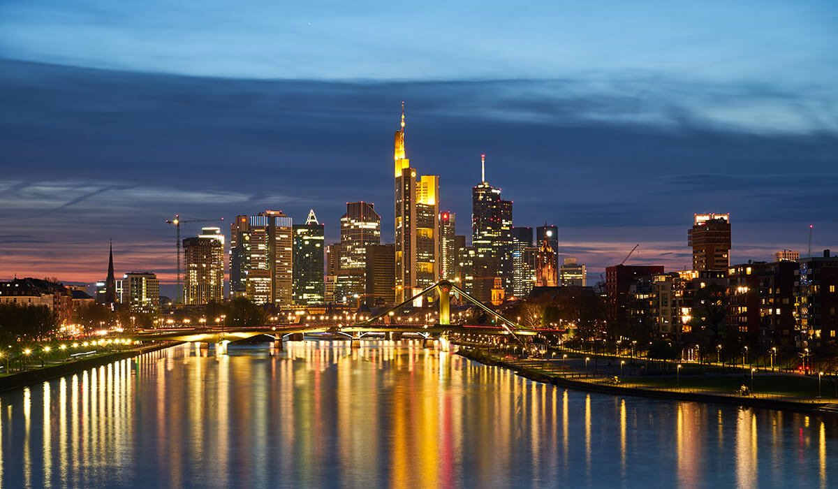 Frankfurt, Germany city at night with lights and river