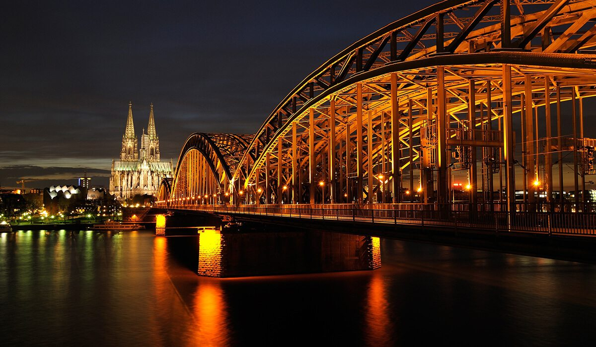 Cologne, Germany night city with lights and bridge
