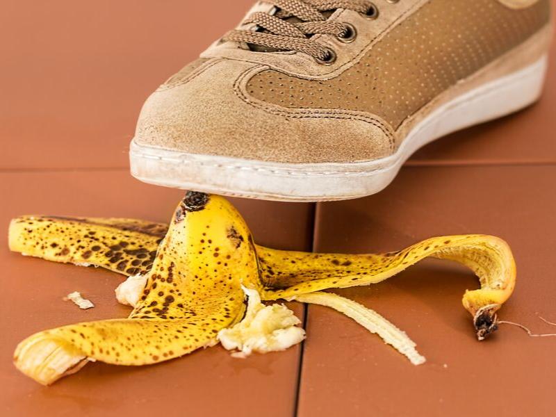 brown shoe stepping on a banana peel