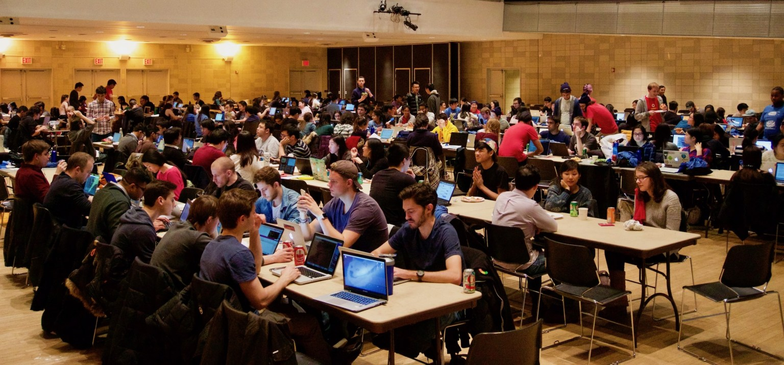 Hackathon in progress, large group, hall