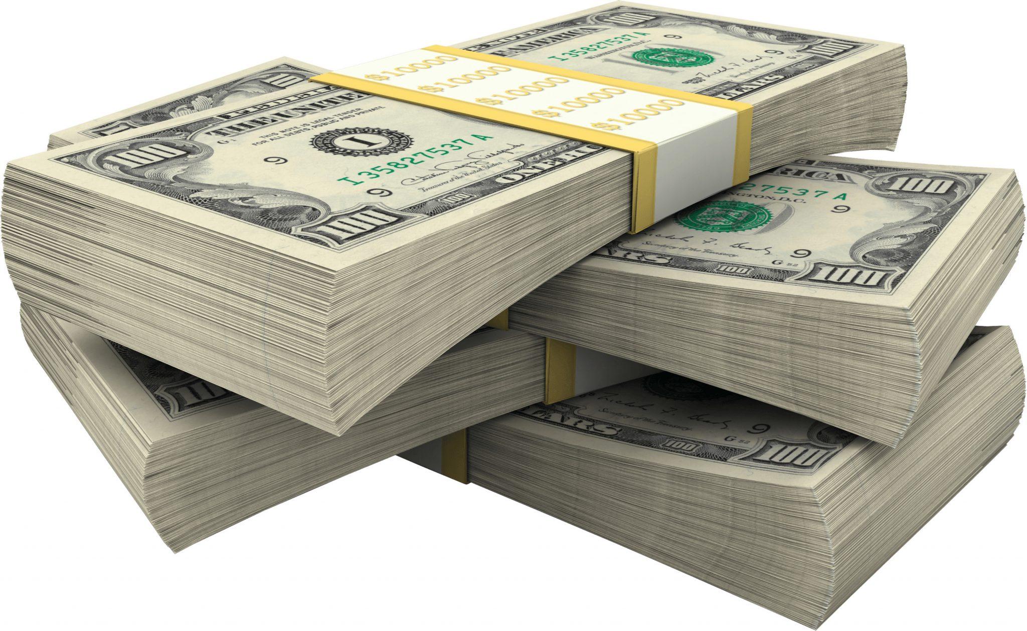 four stacks of hundred dollar bills
