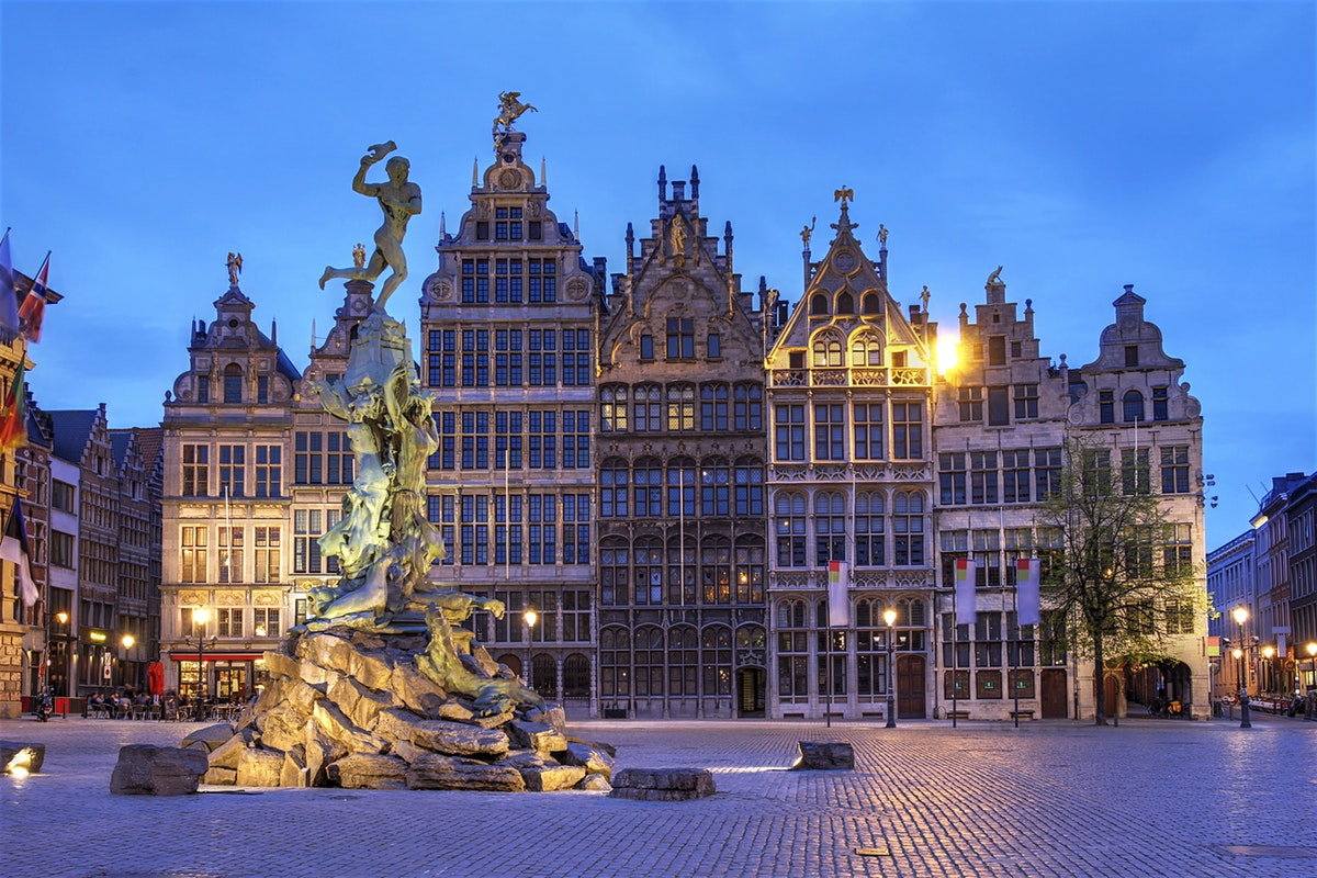 antwerp belgium at night baroque buildings lights statue blue sky clouds