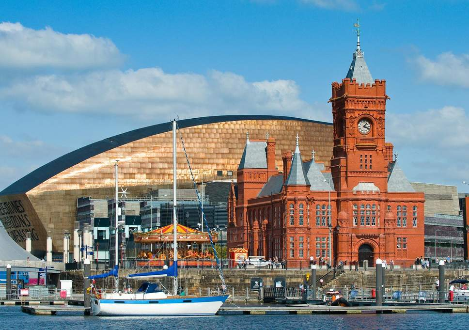 view of cardiff wales uk boats on the water modern architecture and old town hall