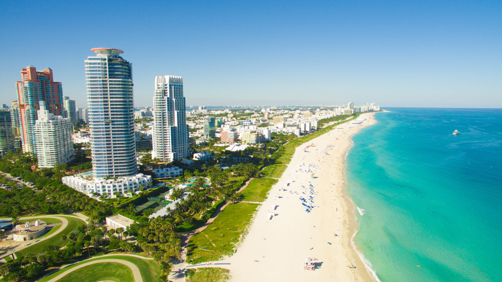 miami florida usa beach and ocean tall buildings green park and blue sky
