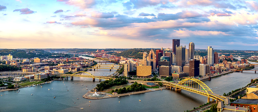 Pittsburgh Pennsylvania city river and bridges cloudy pastel sky