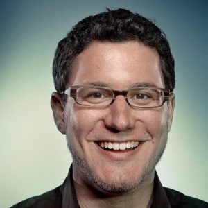 Eric Ries photo white man with black hair on a white and blue background