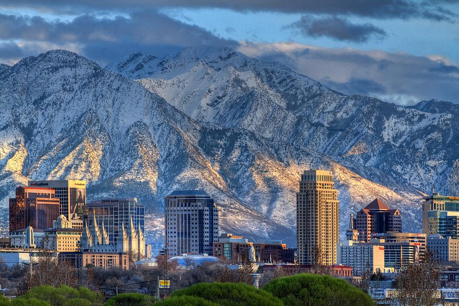 salt lake city utah usa trees tall buildings mountains snow clouds sky