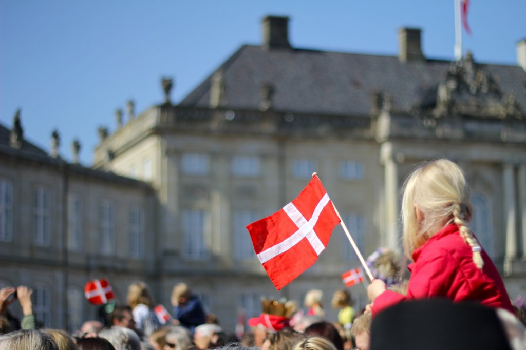 crowd in front of Danish castle with Danish flags