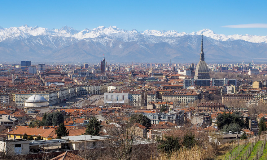 view of turin italy church old buildings trees mountains blue sky