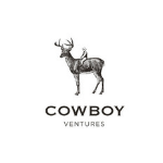 logo, capital black letters, a man sitting on a deer above