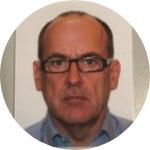 photo of a man, light blue shirt, slightly bold, short brown hair, glasses