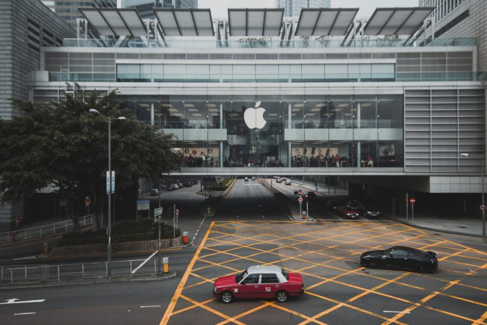 Cars parking in front of the Apple Building