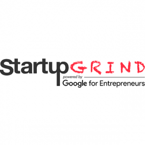 Startup grind powered by google with black and red letters on a white background