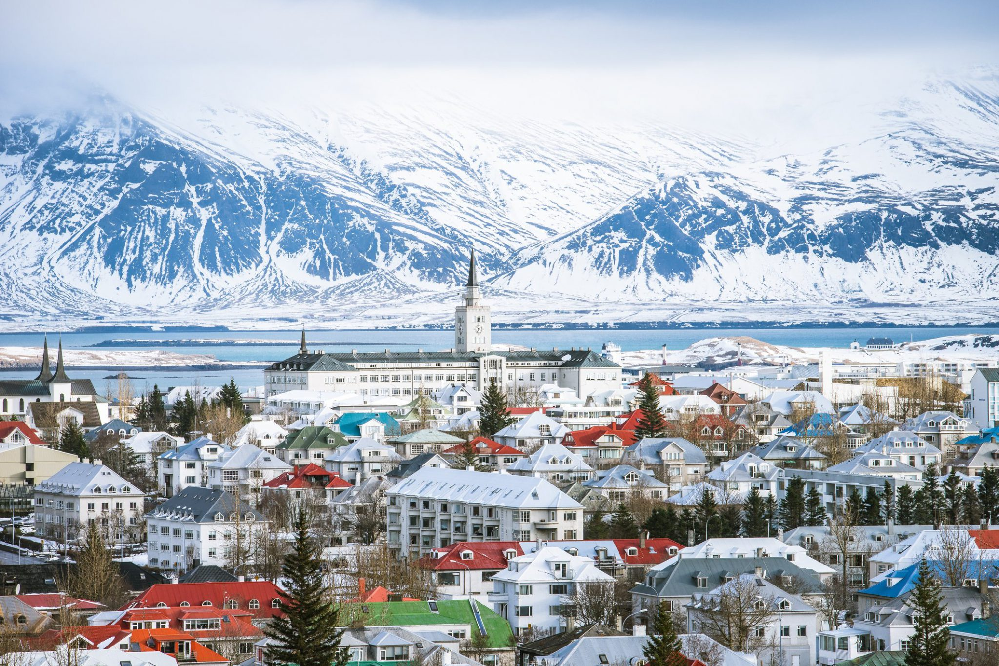 Reykjavik, Iceland city with icy mountains in background