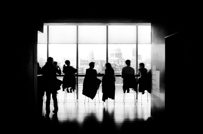 People sitting in a room black and white