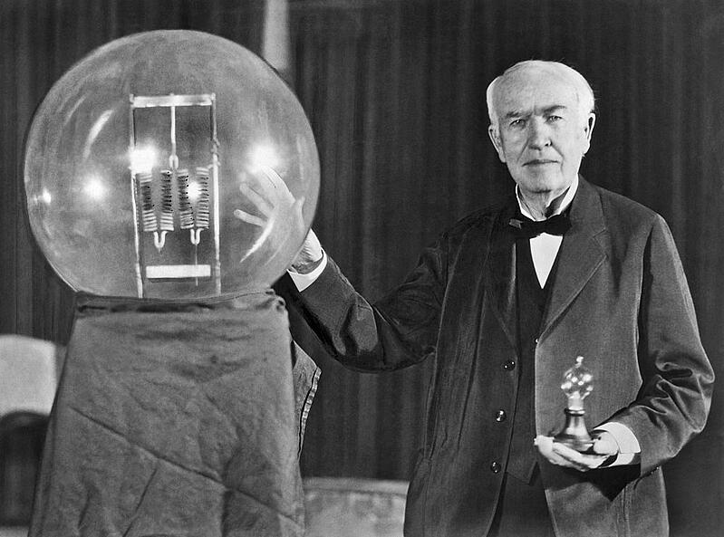Noted inventor Thomas Edison at the lightbulb's golden jubilee anniversary banquet in his honor, Orange, New Jersey, October 16, 1929. He is exhibiting in his hand a replica of his first successful incandescent lamp which gave 16 candlepower of illumination, in contrast to the latest lamp, a 50,000 watt, 150,000 candlepower lamp.