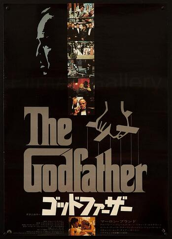 the godfather movie poster with stills from the move, grey and white text over a black background and graphic of a puppeteers hand