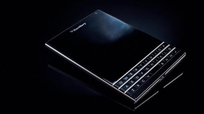 blackberry phone on a black background