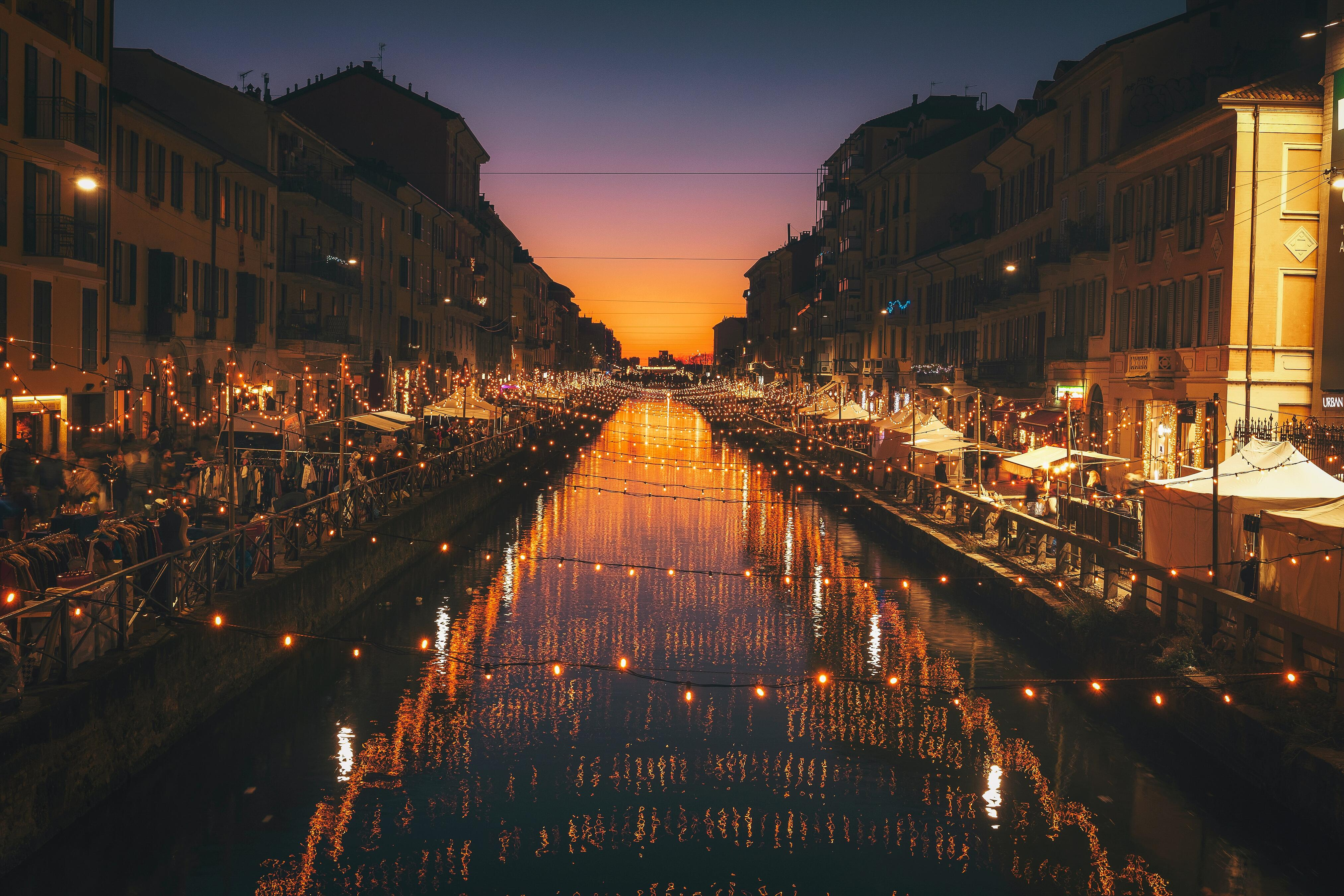 picture of shops on a river in milan, italy
