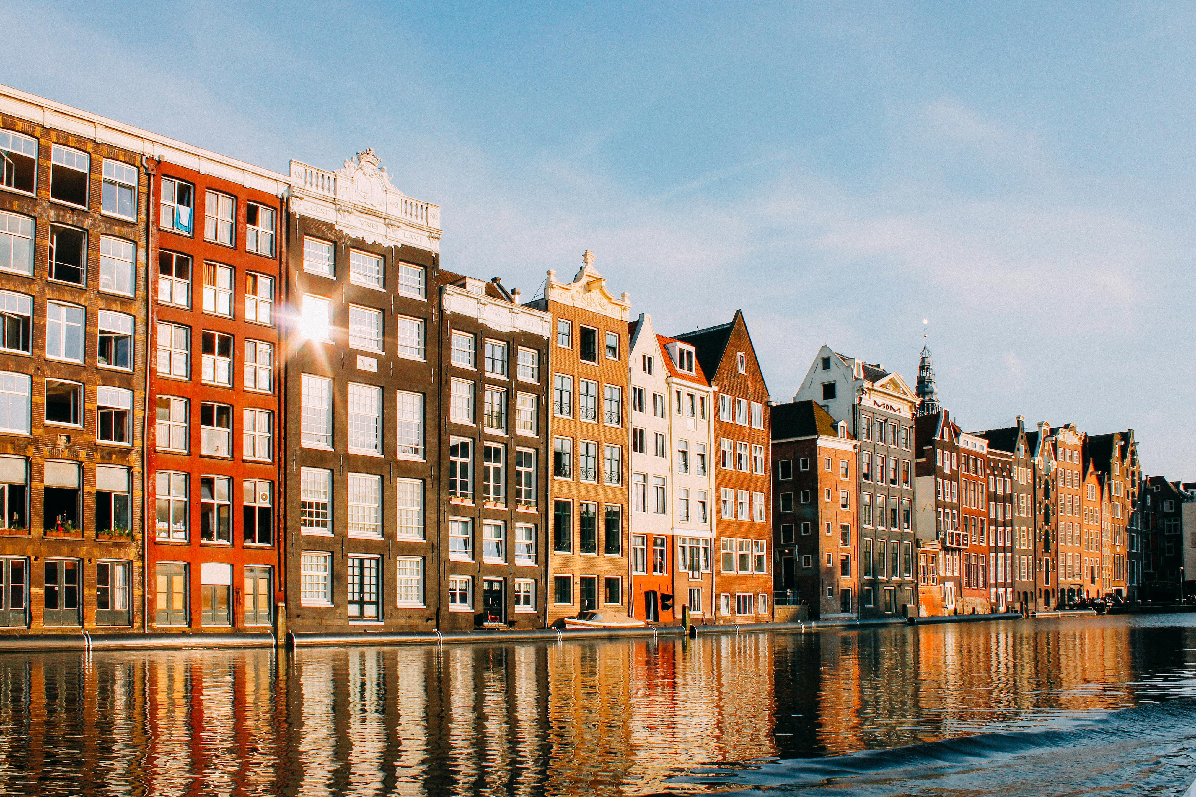 view of houses in amsterdam from the canal