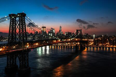 new york at dusk with view by the brooklyn bridge