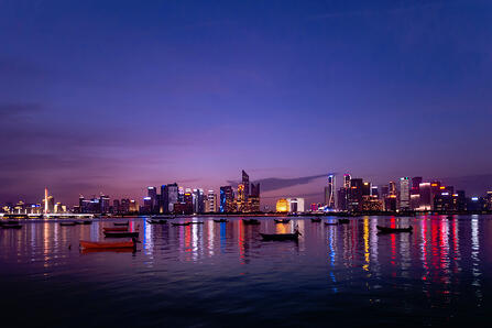 hangzhou skyline from water at dusk