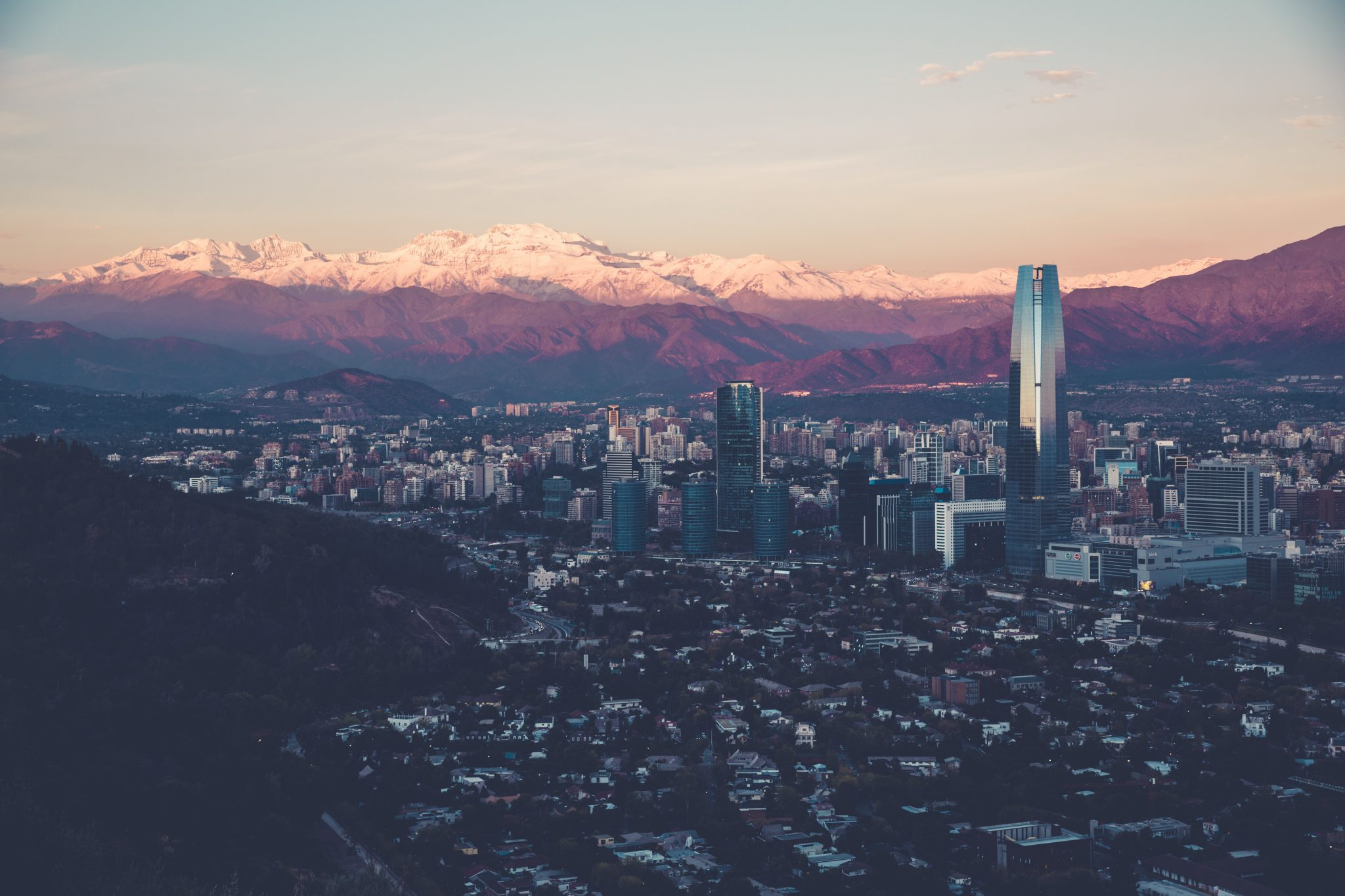 overview shot of santiago, chile with mountains in background